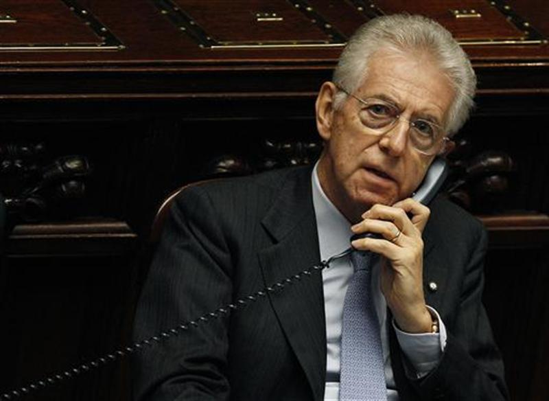 Italy's Prime Minister Mario Monti talks on the phone during a vote of confidence at the Lower House of Parliament in Rome