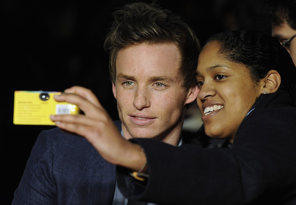 Cast member Redmayne poses for a picture with a fan at the European premiere of quotMy Week With Marilynquot in London