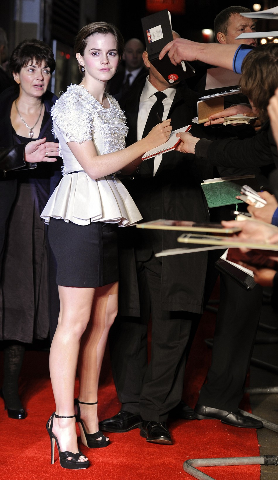 Emma Watson signs autographs for fans during the European premiere of quotMy Week With Marilynquot in London