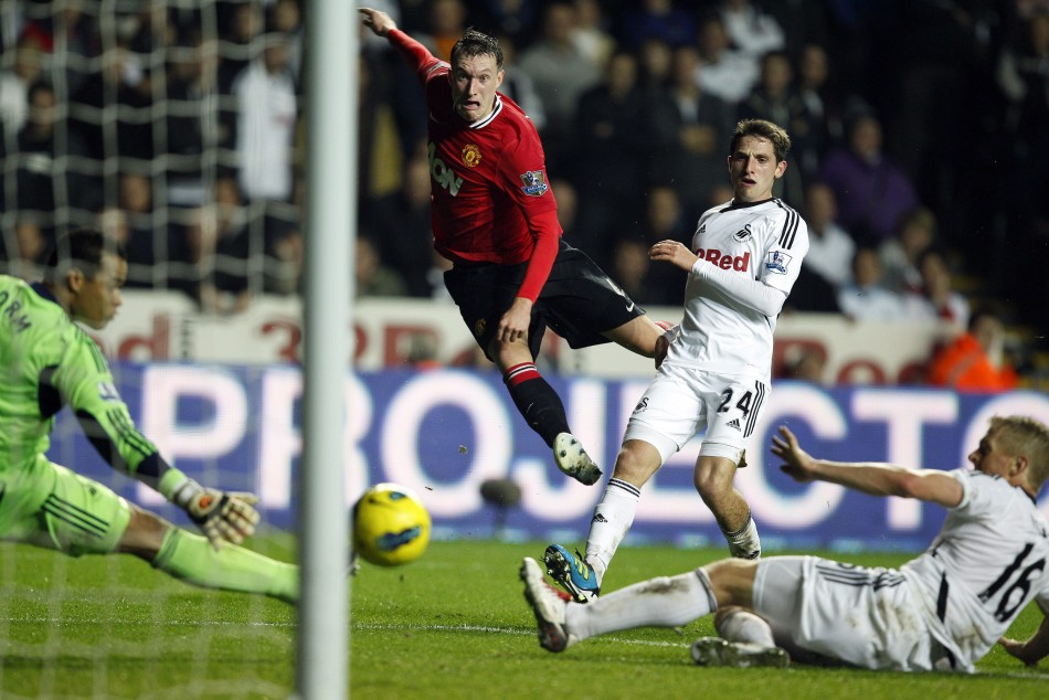 Manchester United's Jones shoots at goal during their English Premier League soccer match against Swansea City at the Liberty Stadium in Swansea