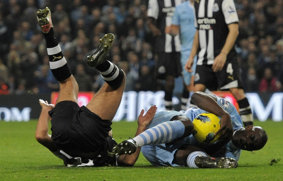 Newcastle United's Arfa challenges Manchester City's Richards to concede a penalty during their English Premier League soccer match in Manchester