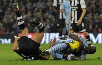 Newcastle Uniteds Arfa challenges Manchester Citys Richards to concede a penalty during their English Premier League soccer match in Manchester