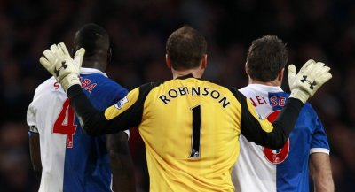 Blackburn Rovers goalkeeper Paul Robinson congratulates his defenders Christopher Samba and Ryan Nelsen after their English Premier League soccer match against Arsenal in London