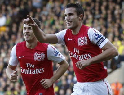 Arsenal039s Van Persie celebrates his first goal against Norwich City during their English Premier League soccer match in Norwich