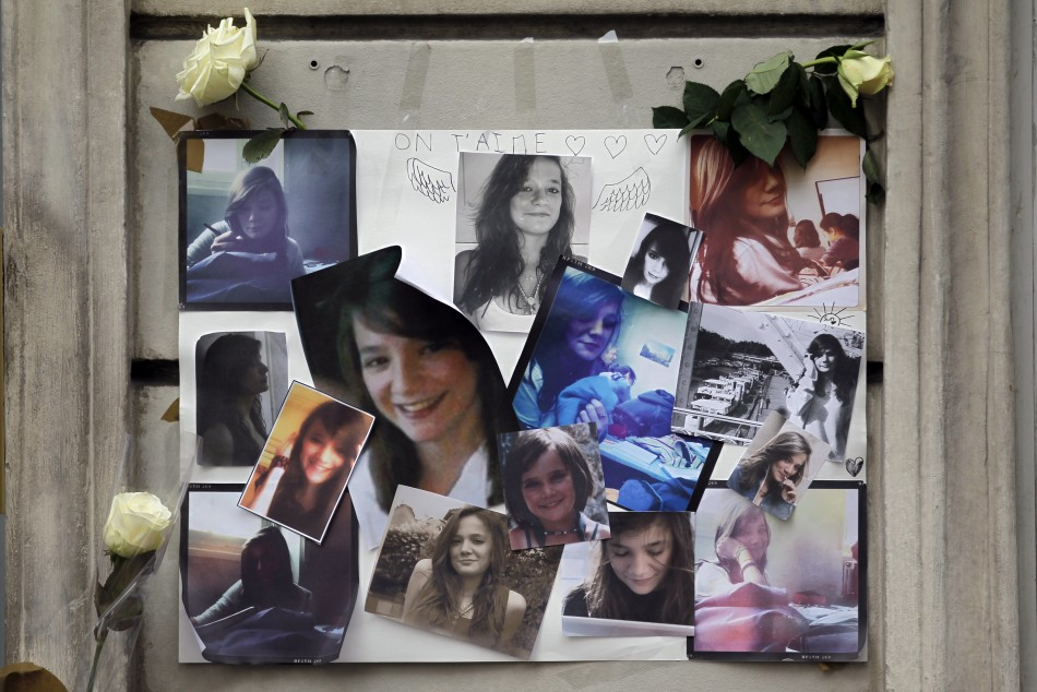 Photographs of Agnes, the 13-year-old murdered French teenager, are displayed outside the building where her parents reside in Paris