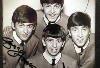 An autographed photo of The Beatles is displayed at an exhibition in Buenos Aires October 4, 2010.