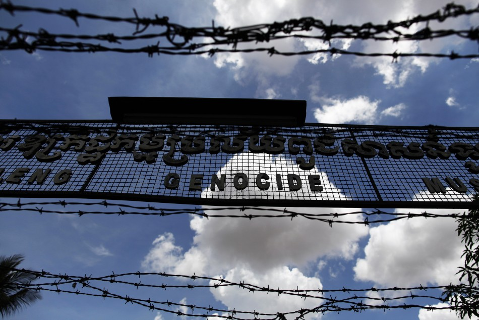 The sign above the entrance of Tuol Sleng Genocide Museum is seen through razor wire in Phnom Penh