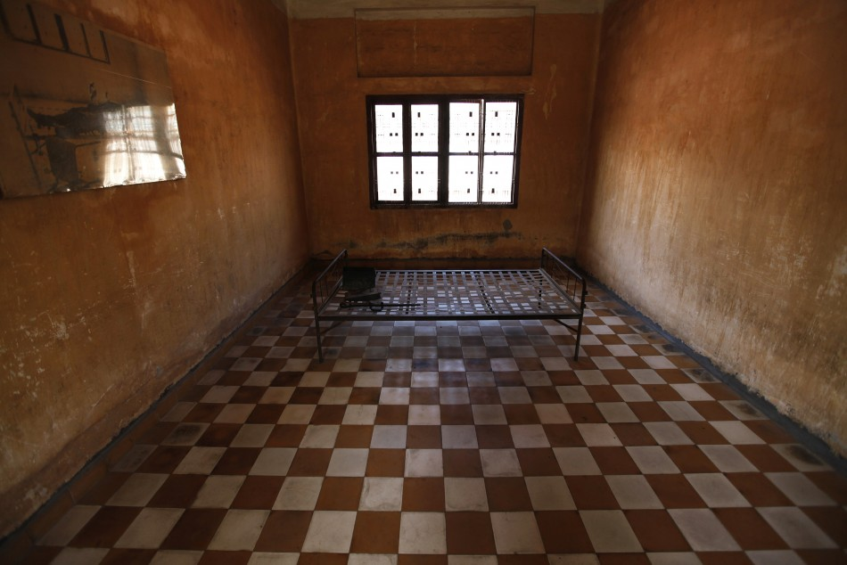 Torture instruments on a bed frame are seen in a room once used as a torture chamber at the Tuol Sleng Genocide Museum in Phnom Penh