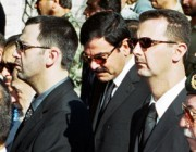 Syrian President Bashar al-Assad , his brother Maher and brother-in-law Asef Shawkat stand during funeral of late President Hafez al-Assad in Damascus