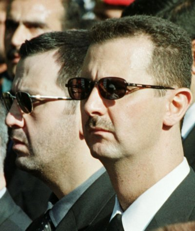Maher Assad, 37, Head of the Presidential Guard left with brother Bashar Al Assad, President of Syria