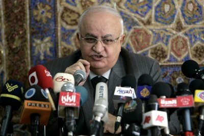 Syrian former Prime Minister Naji al-Otari speaks during a news conference with Jordans Prime Minister Nader Dahabi in Amman