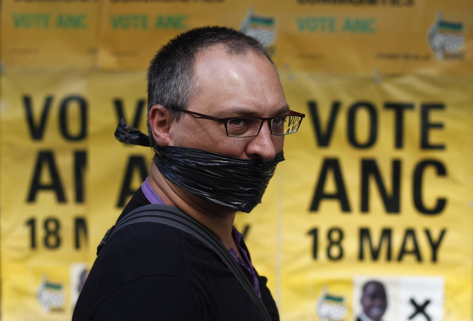 A protester looks on outside the ruling ANC headquarters, during a protest against the passing of new laws on state secrets in Johannesburg