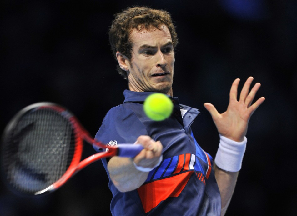Murray of Britain returns the ball during his singles tennis match against Ferrer of Spain at the ATP World Tour Finals in London