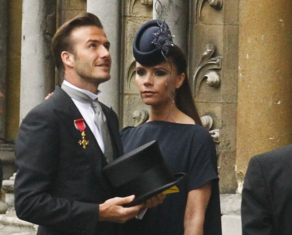 Soccer star David Beckham and his wife Victoria arrive at Westminster Abbey before the wedding of Britain's Prince William and Kate Middleton, in central London