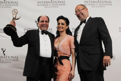 Directorate Award winner Chandra poses for photographers along with presenters Panjabi and Parsons at the awards