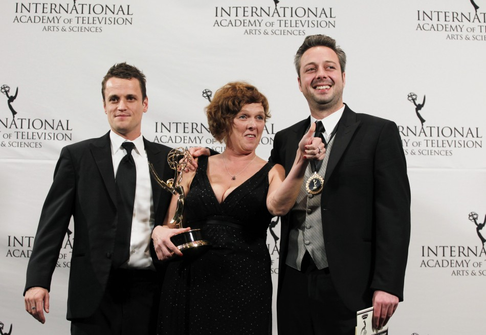 "Comedy winners for ""Benidorm Bastards"" Tim Van Aelst, Katrien Van Nieuwenhove and Tom Baetens pose for photographers"