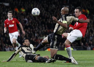 Manchester Uniteds Berbatov shoots at the Benfica goal during their Champions League soccer match