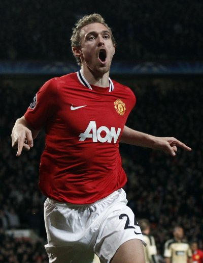Manchester Uniteds Fletcher celebrates his goal against Benfica during their Champions League soccer match in Manchester