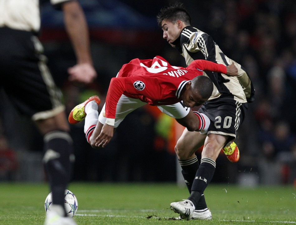 Benficas Gaitan challenges Manchester Uniteds Young during their Champions League Group C soccer match in Manchester