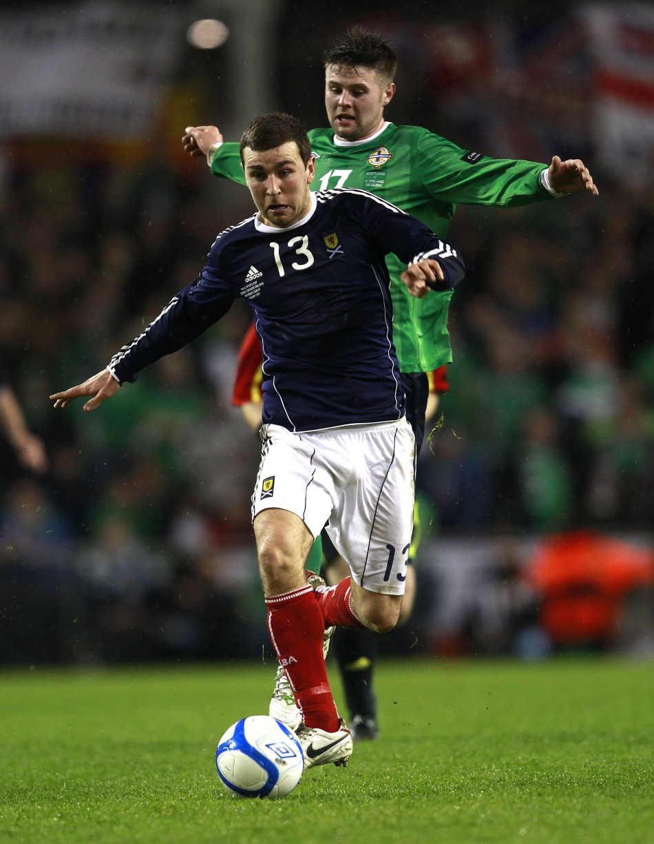 Northern Ireland's Oliver Norwood challenges Scotland's James McArthur during their Nations Cup soccer match at the Aviva Stadium in Dublin