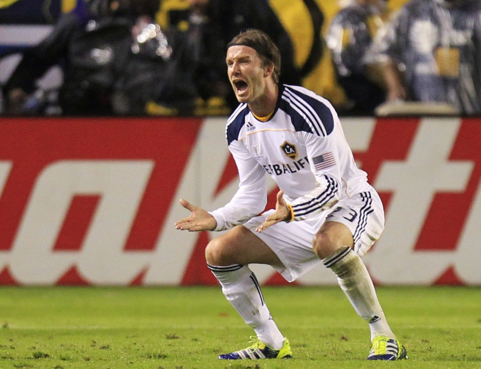 Los Angeles Galaxy's David Beckham reacts after teammate Landon Donovan scored against the Houston Dynamo during the MLS Cup final