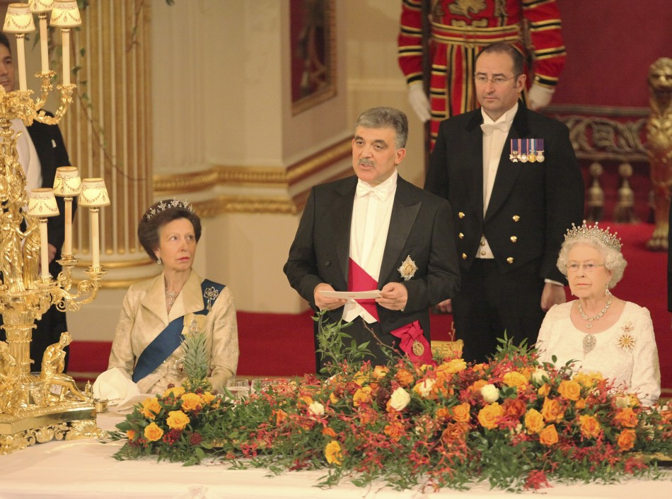 Queen Elizabeth (R), and Princess Anne (L) listen to a speech by the President of Turkey, Abdullah Gul, at a state banquet in Buckingham Palace, in central London November 22, 2011.