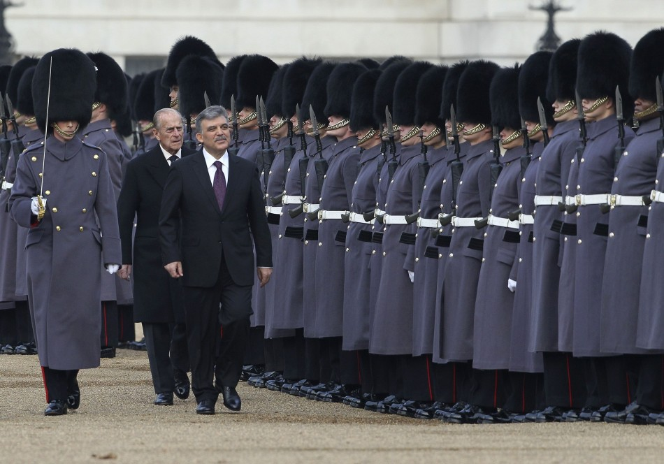 The President of Turkey Abdullah Gul FRONT R, accompanied by Britains Prince Philip FRONT C reviews a Guard of Honour on Horse Guards Parade, in central London November 22, 2011.