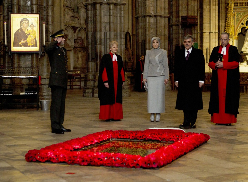 The President of Turkey Abdullah Gul (2nd R), accompanied by his wife Hayrunnnisa (3rd L), stands at the tomb of the unknown soldier in Westminster Abbey in central London November 22, 2011