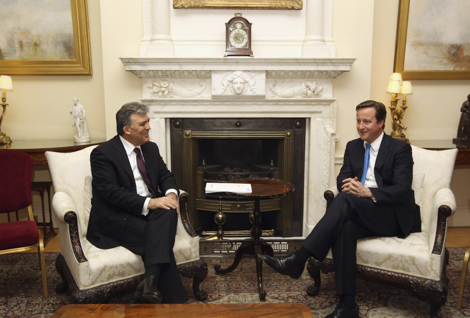 The President of Turkey Abdullah Gul (L) speaks to Britain's Prime Minister David Cameron in 10 Downing Street.