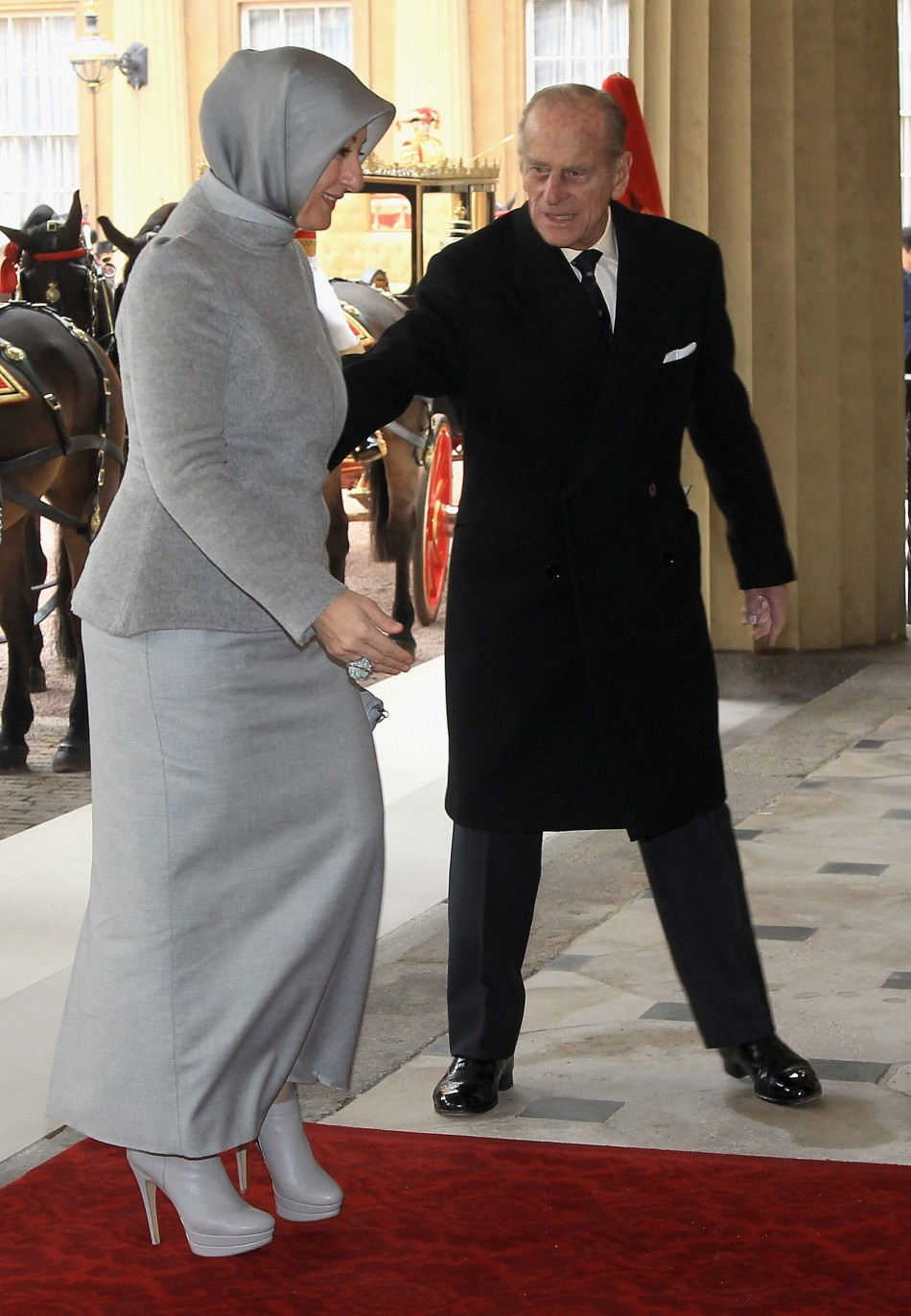 Hayrunnisa Gul L, wife of Turkeys President Abdullah Gul, arrives at Buckingham Palace with Britains Prince Philip during a state visit in London November 22, 2011.