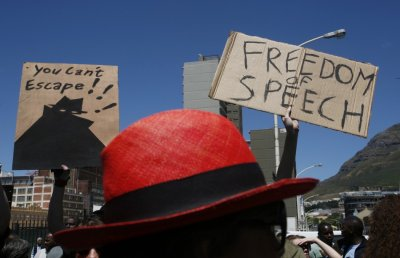 Demonstrators protest against the passing of the Protection of Information Bill outside Parliament in Cape Town