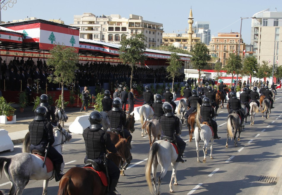 Security forces ride horses as they take part in a military parade to celebrate the 68th anniversary of Lebanons independence day in Beirut