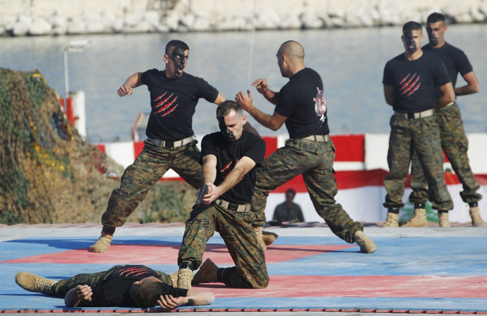 Commandos stage a combat drill during a military parade to celebrate the 68th anniversary of Lebanon's independence day in Beirut