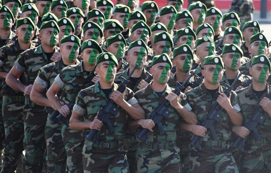 Soldiers take part in a military parade to celebrate the 68th anniversary of Lebanons independence day in downtown Beirut