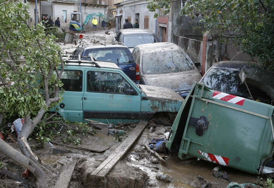 Cars are seen stranded in mud following a landslide at Scarcelli, a district of Saponara, in the province of Messina, in Sicily November 23, 2011