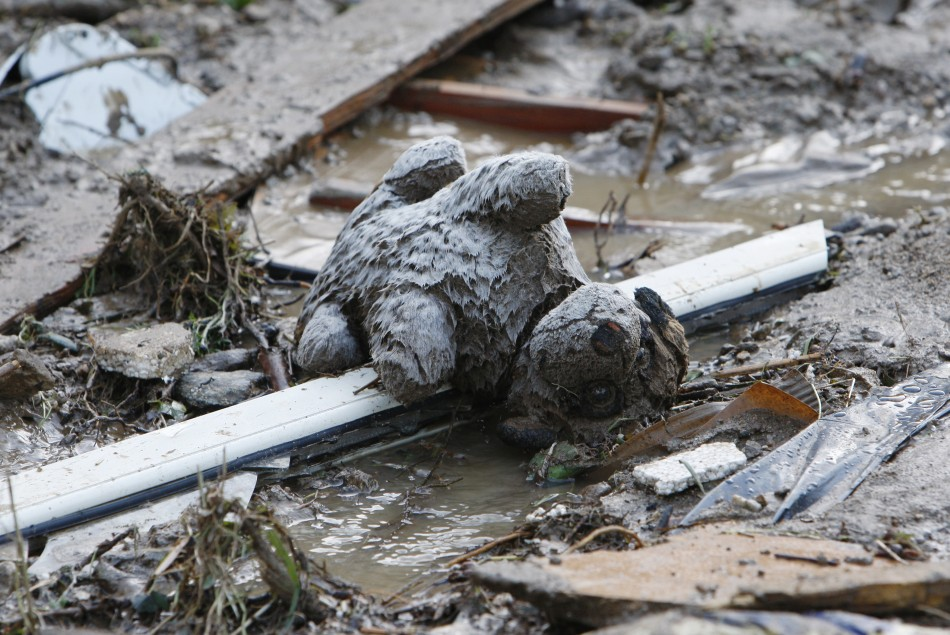 A teddy bear lies in the mud following a landslide at Scarcelli, a district of Saponara, in the province of Messina, in Sicily November 23, 2011