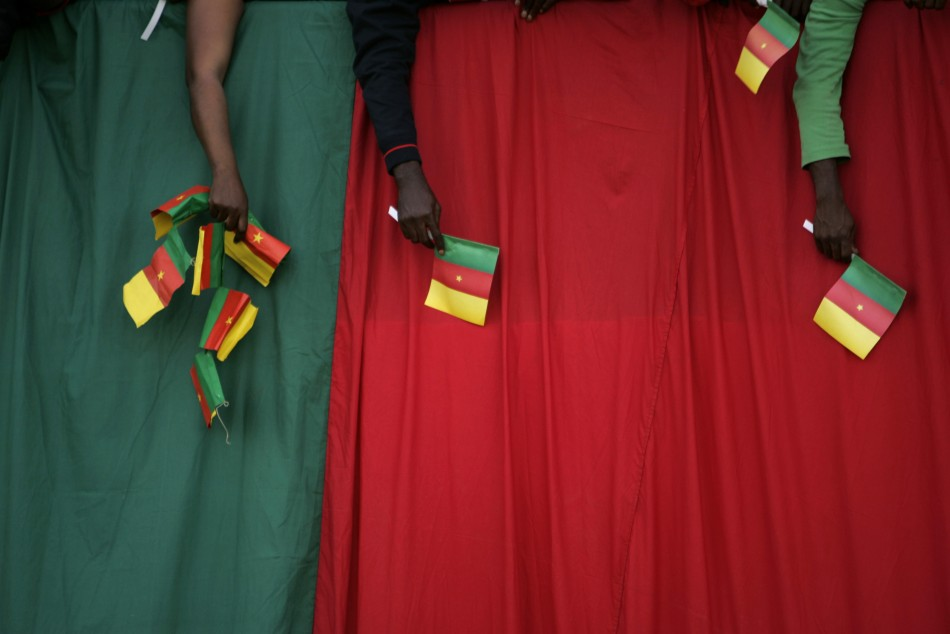 Cameroon supporters hold flags