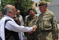 Afghan official with British Army officer.
