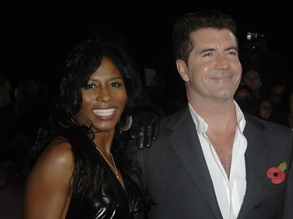 """Singer Sinitta and Simon Cowell pose at the """"National Television Awards"""" in London"""