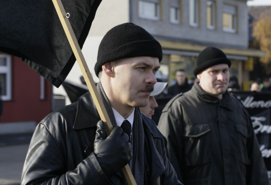 A neo-Nazi carries a black flag during an ultra right-wing rally in Remagen