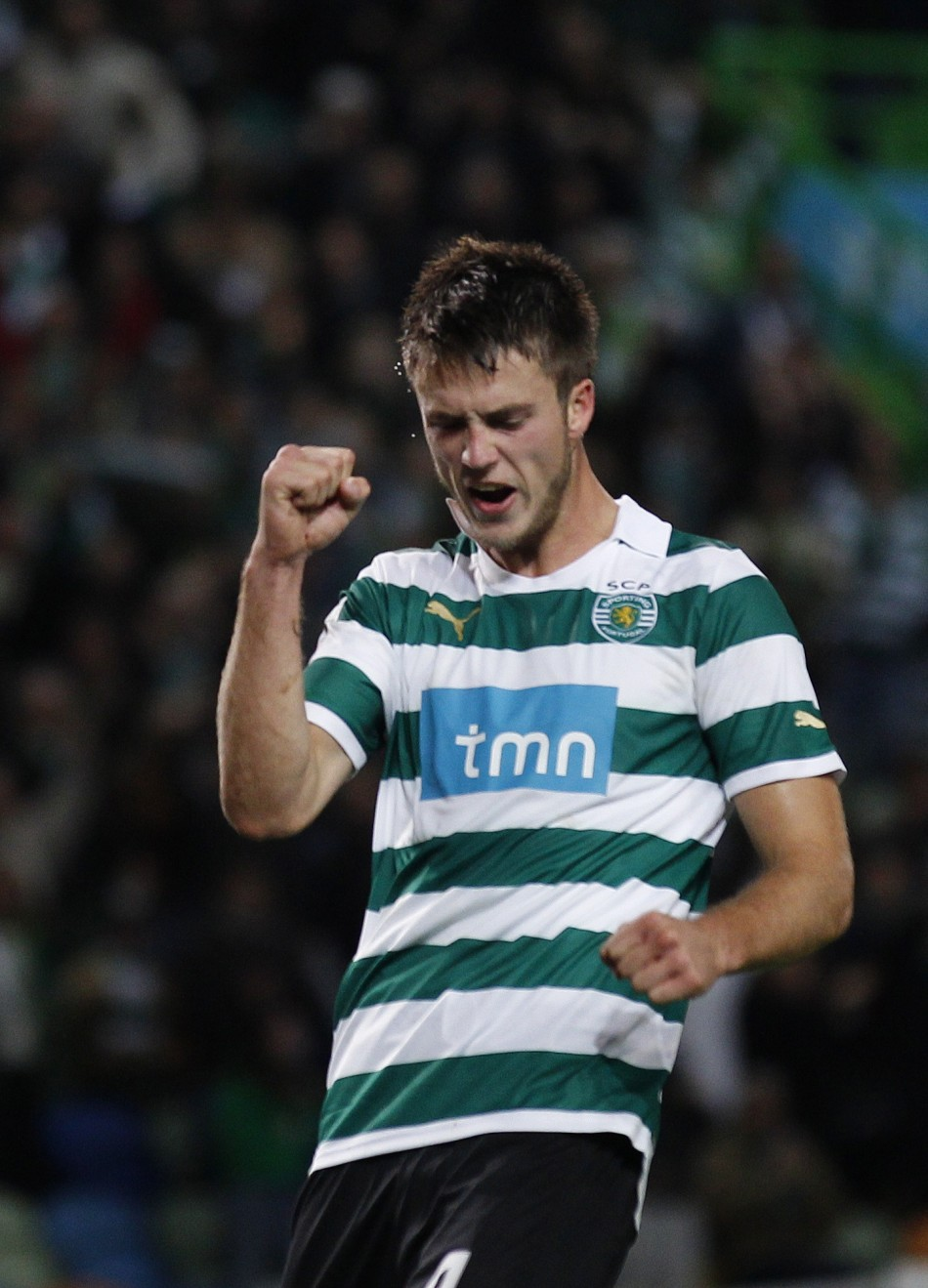 Sporting's Ricky van Wolfswinkel celebrates his goal against Leiria during their Portuguese Premier League soccer match at Alvalade stadium in Lisbon