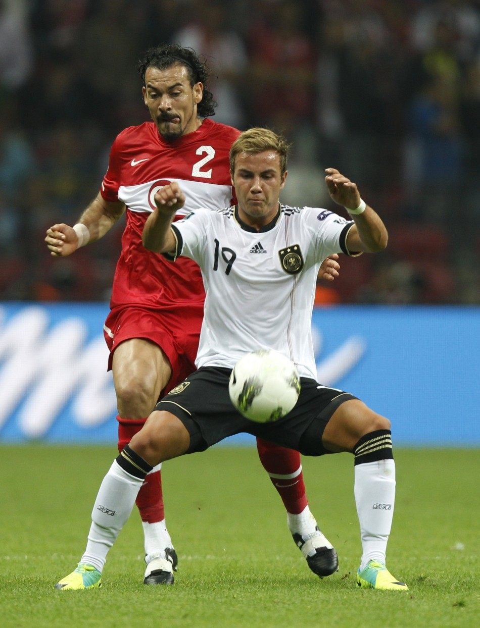 Germanys Gotze challenges Turkeys Cetin during their Euro 2012 qualifying Group A soccer match at Turk Telekom Arena in Istanbul