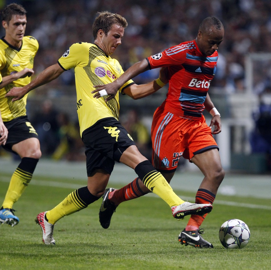 Olympique Marseilles Ayew challenges Borussia Dortmunds Gotze during their UEFA Champions League soccer match at the Velodrome stadium in Marseille