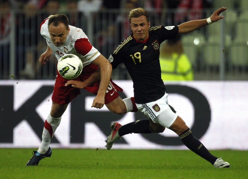 Germany's Gotze fights for the ball with Poland's Glowacki during their international friendly soccer match in Gdansk