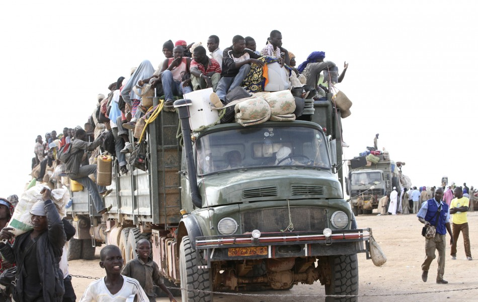 A truck transporting immigrants, who are fleeing the unrest in Libya, and their belongings, arrives in Agadez, northern Niger September 15, 2011.