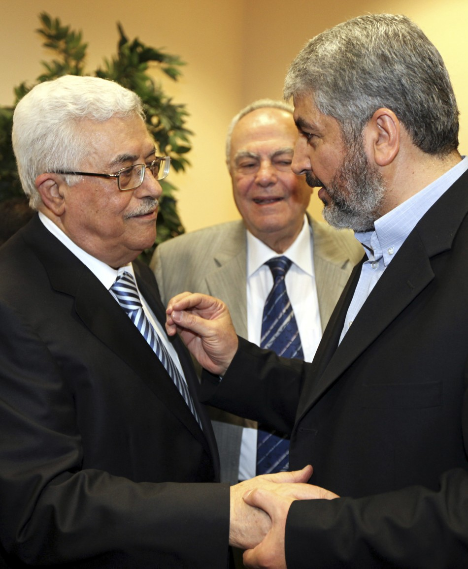 Hamas leader Meshaal talks with President Abbas during their meeting in Cairo