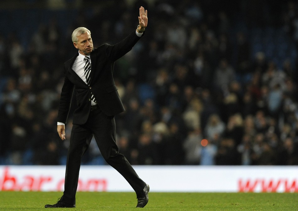 Newcastle United's coach Pardew reacts after their English Premier League soccer match against Manchester City in Manchester