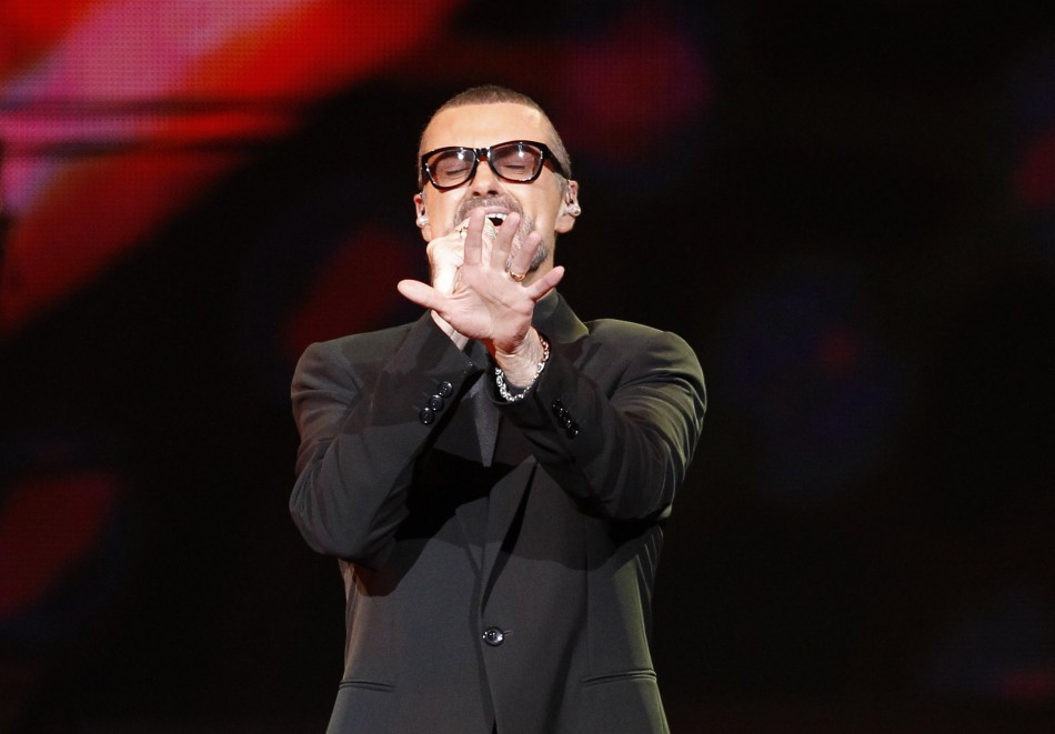 """British singer George Michael performs on stage during his """"Symphonica"""" tour concert in Berlin"""