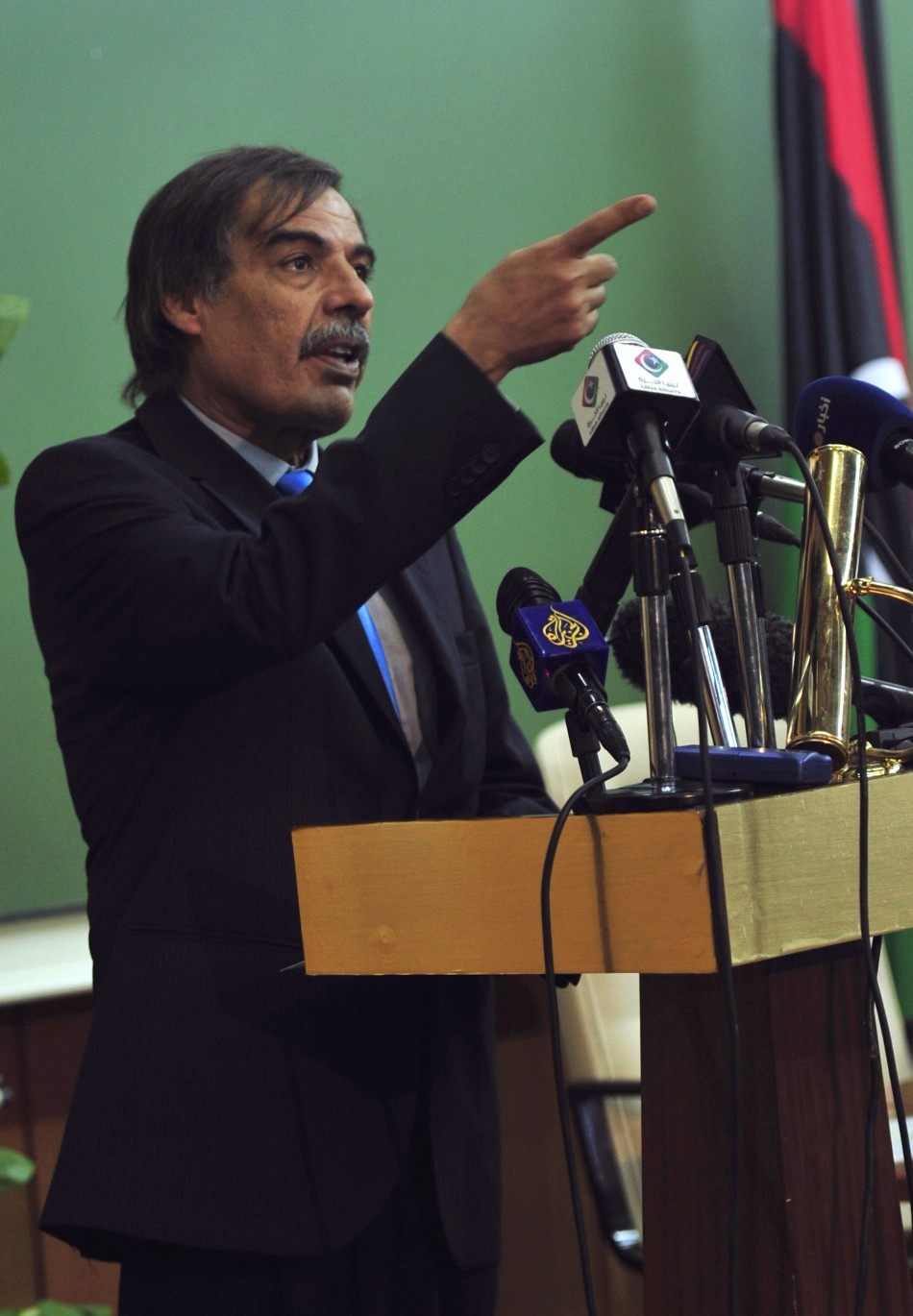 Ali Tarhouni, Libyan National Transitional Council's minister for oil and finance, attends a news conference in Benghazi