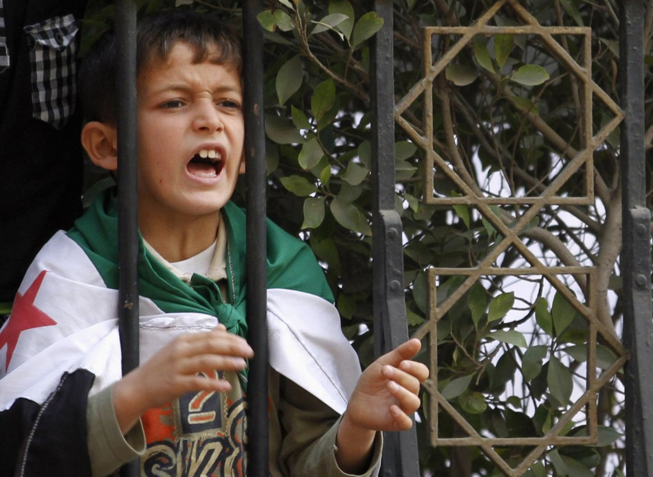 A Syrian boy shout slogans against Syrian President Assad during a protest